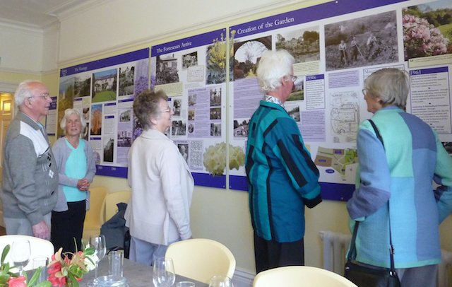 Nancy Fortescue (second from right) views The Garden House story display.jpg
