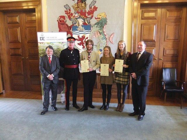 Isabelle & Devon Lord Lt receiving Gold