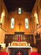 Our Lady - altar , crucifix and 3 stained glass windows.jpg