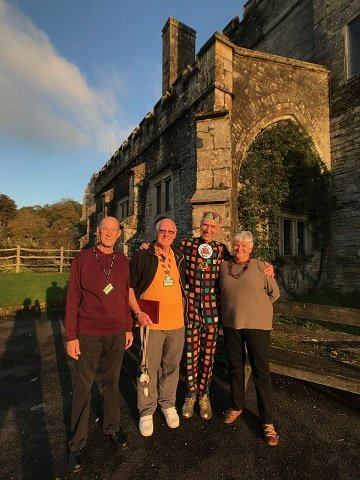 Buckland Abbey Art Ambassadors Colin Briggs Barry Coley and Liz Benfield with sculptor Andrew Logan at Buckland Abbey