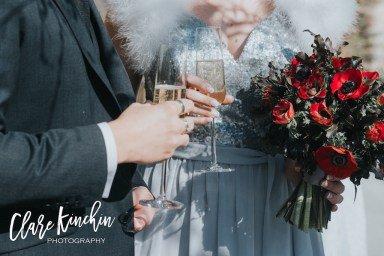 Amanda-Randell-red-and-black-wedding-bouquet-with-grey-silk-ribbon.jpg