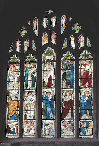 The William Morris window, behind the altar of St Mary Magdalene Chapel, erected 1876 as a memorial to John Hornbrook Gill, of Bickham Hall, a local banker and magistrate, whose son.jpg
