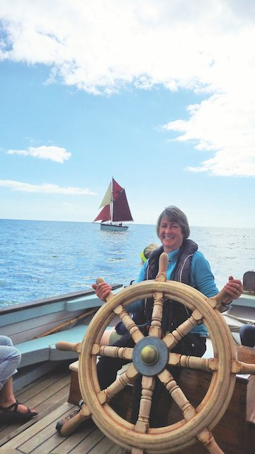 Sue at the helm, in Torbay with Golden Vanity (photo by Jo Coomber).JPG