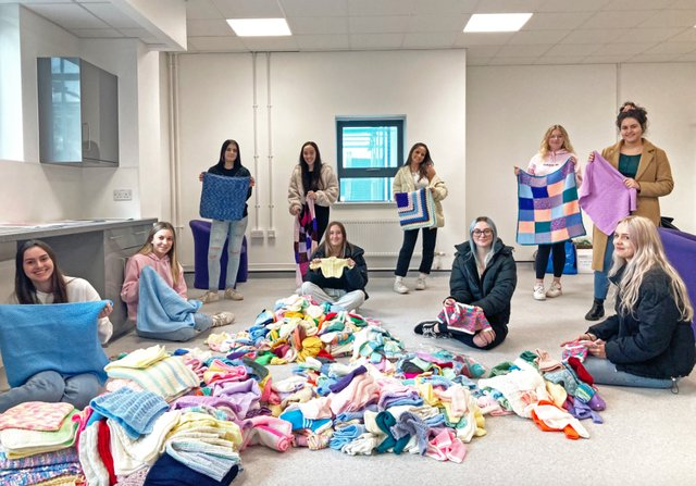 Exeter College students collect knitted baby items for charity