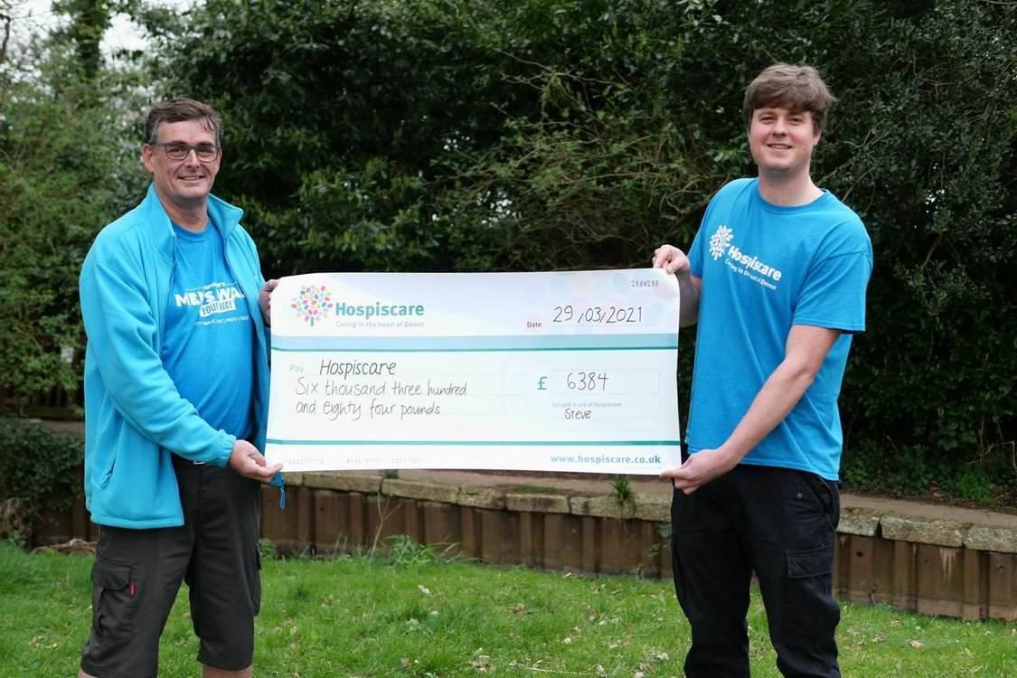 Men's Walk Top Fundraiser Steve Pearcy Presenting his Cheque To Hospiscare Fundraiser Martin Stokke