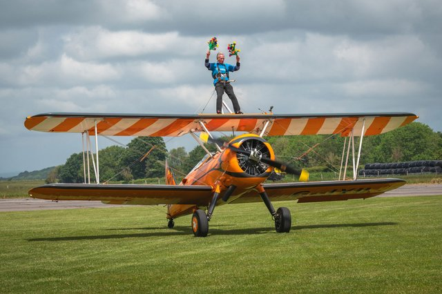 Bill's Wing Walk landing with flowers ready for the pilot and his wife, Anne