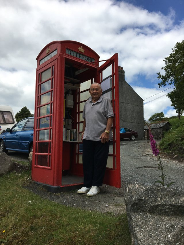 Cllr Taffurelli at the old phone box in Wotter