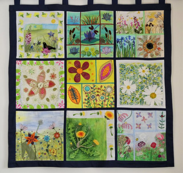 The hanging, consisting of nine panels of textile flowers, is on display in Okehampton Medical Centre.
